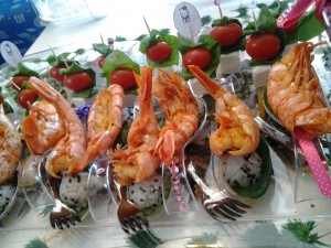 Peri Prawn Spoons with lemon & black sesame seed rice served on a baby spinach leaf